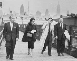 RT Cohen, Elizabeth Taylor, Michael Todd and a fourth man stroll the gangway, October 18, 1957.