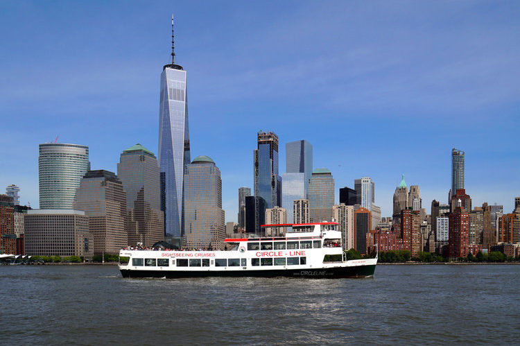 Circle-Line boat with the NYC skyline in the background.