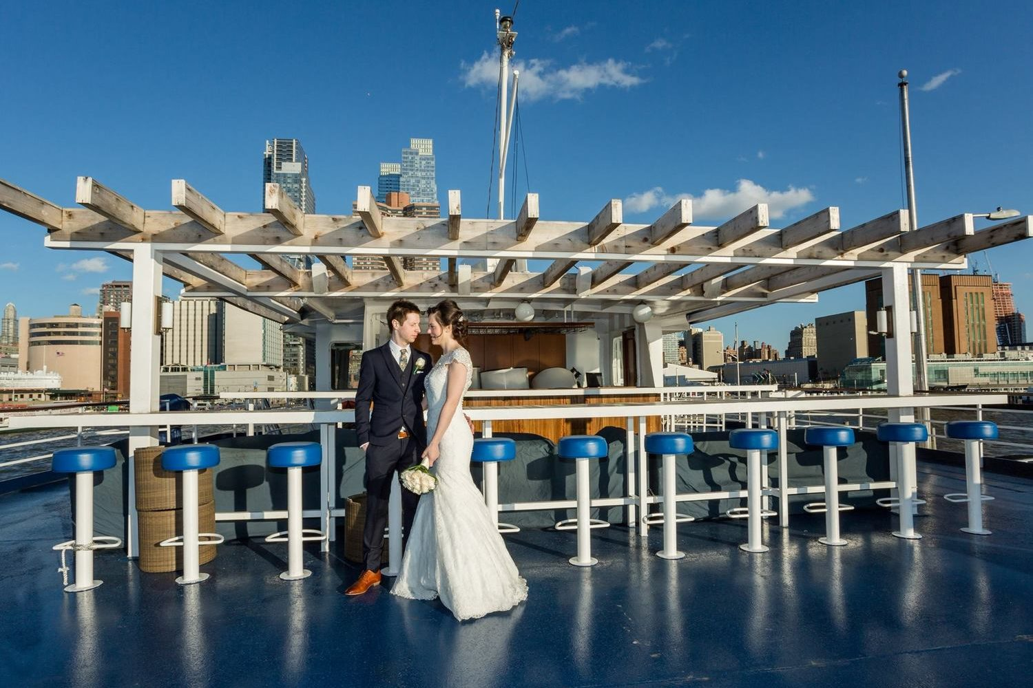 World Yacht Cruises boat on the rooftop with a wedding couple.